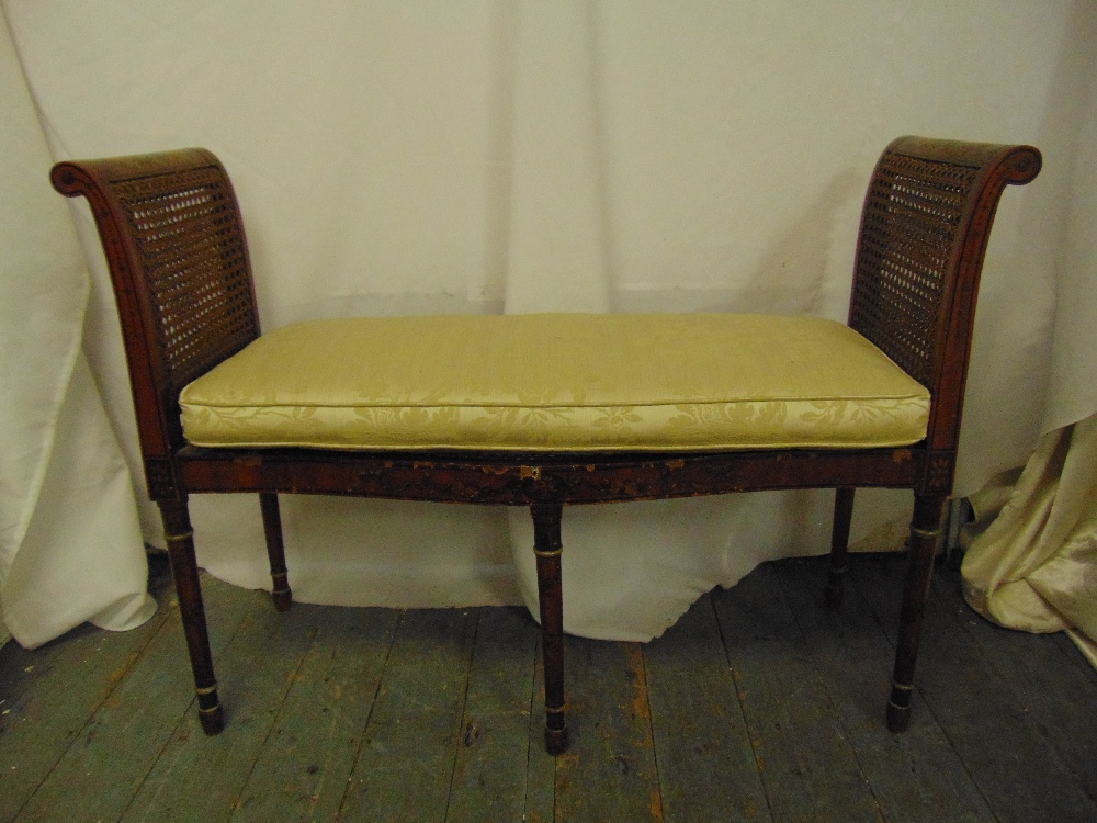 Lot 37 - An Edwardian rectangular two seater Sheraton style love seat with scroll sides, bergere seat, on
