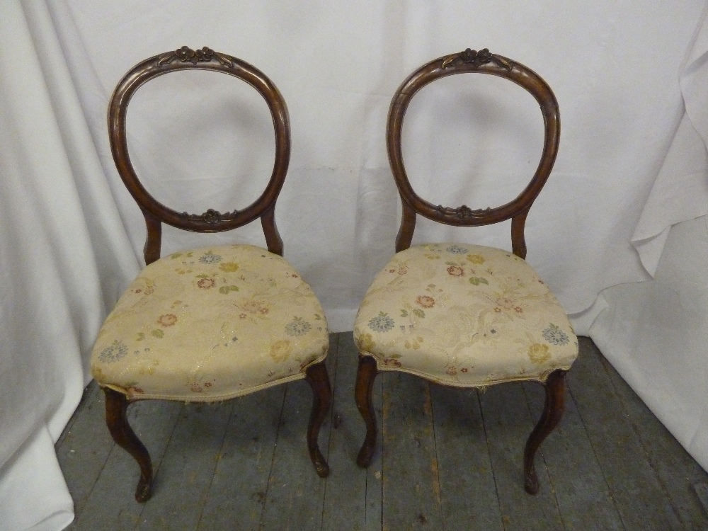 Lot 41 - A pair of Victorian mahogany upholstered occasional chairs on four scroll legs