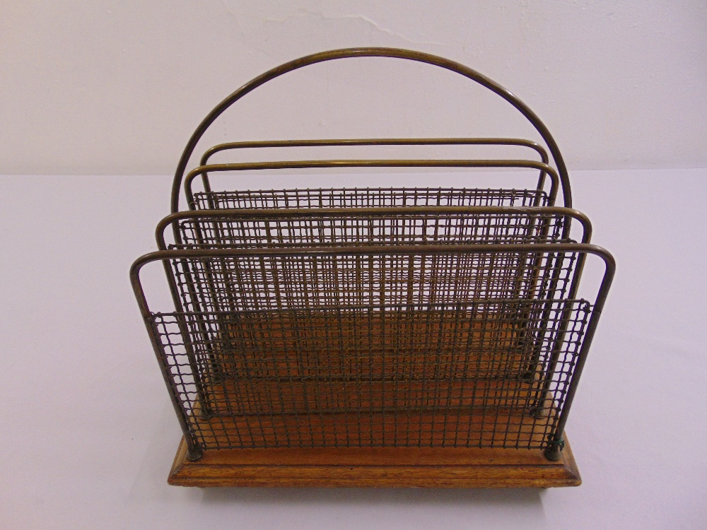 Lot 34 - An Edwardian rectangular mahogany and brass magazine rack with central carrying handle