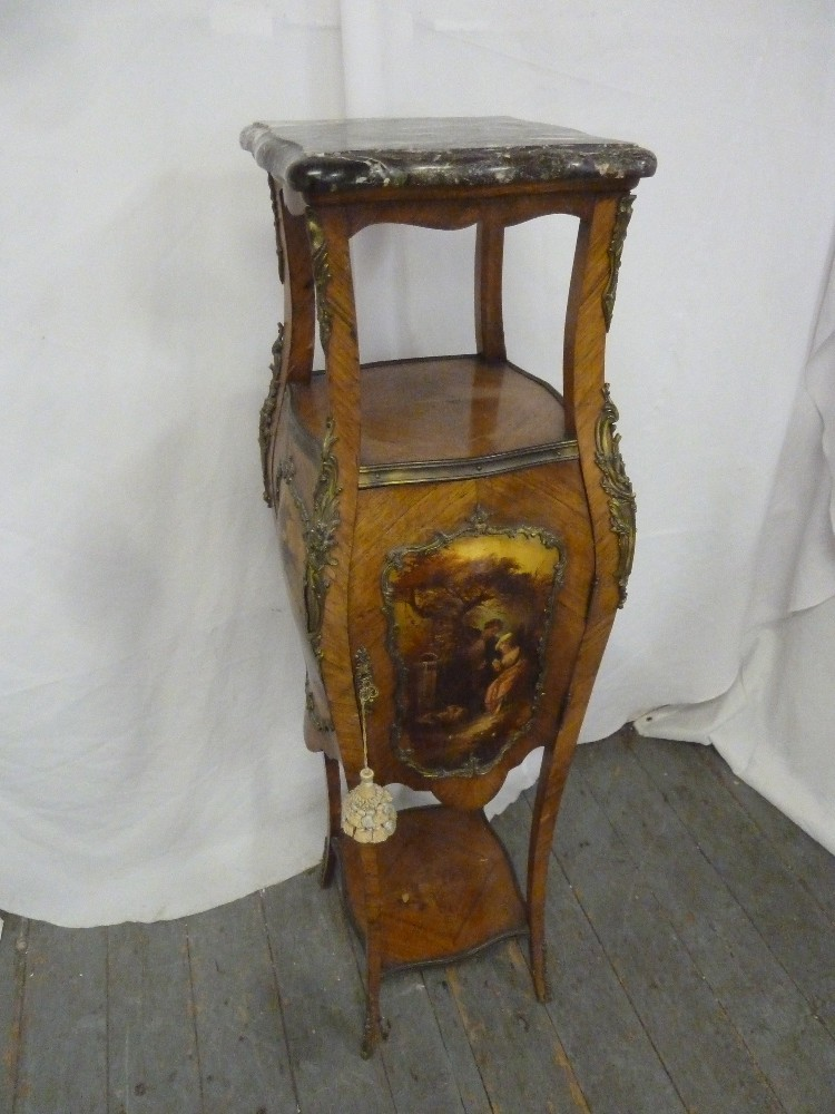 Lot 10 - A Louis XVI style Kingswood plant stand with marble top above a hinged cupboard supporting three