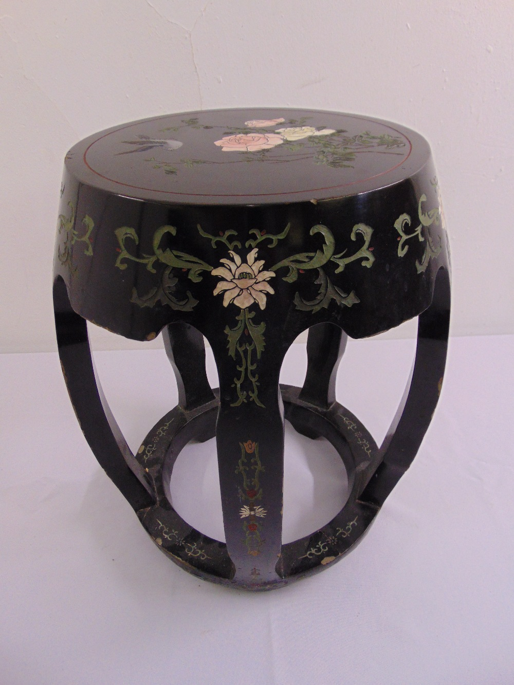 Lot 31 - A mid 20th century conical shaped garden seat lacquered and painted with flowers and leaves in the