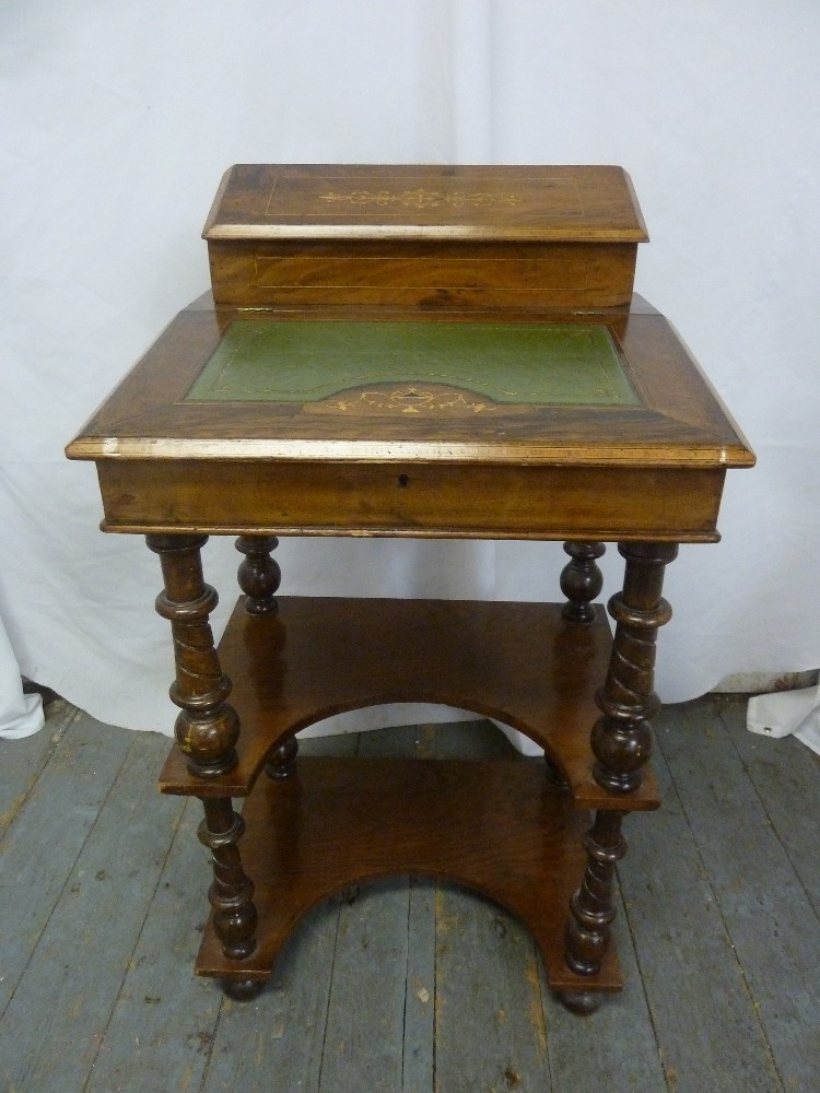 Lot 1 - A rectangular mahogany desk with tooled leather hinged top, inlaid decoration on four turned knopped