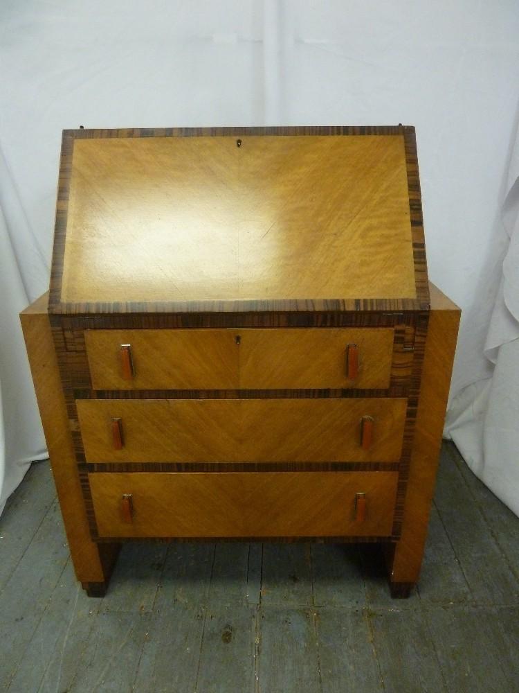 Lot 3 - A rectangular Art Deco satinwood bureau with coromandel borders, three drawers with Bakelite handles