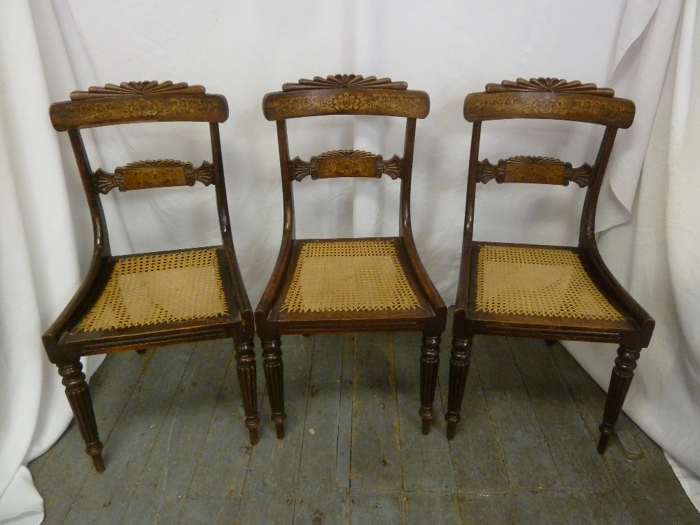 Lot 38 - Three Regency mahogany inlaid dining chairs with bergere seats on tapering cylindrical legs, A/F