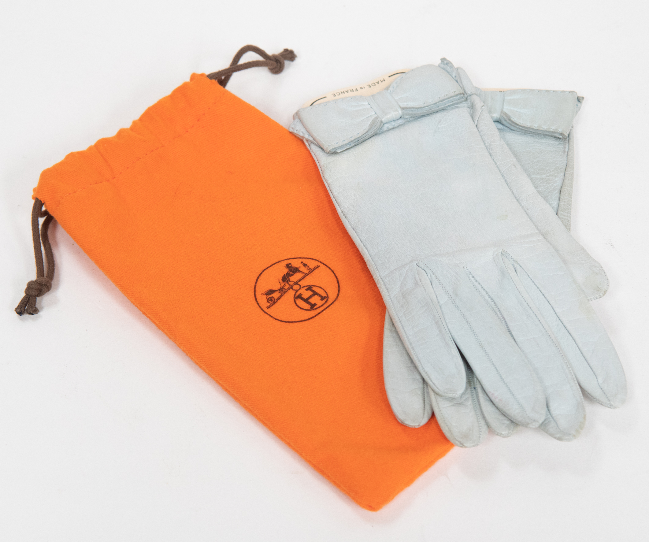 863bac3b0629 Lot 1301 - HERMES a pair of Hermes vintage leather gloves, pale blue soft  leather