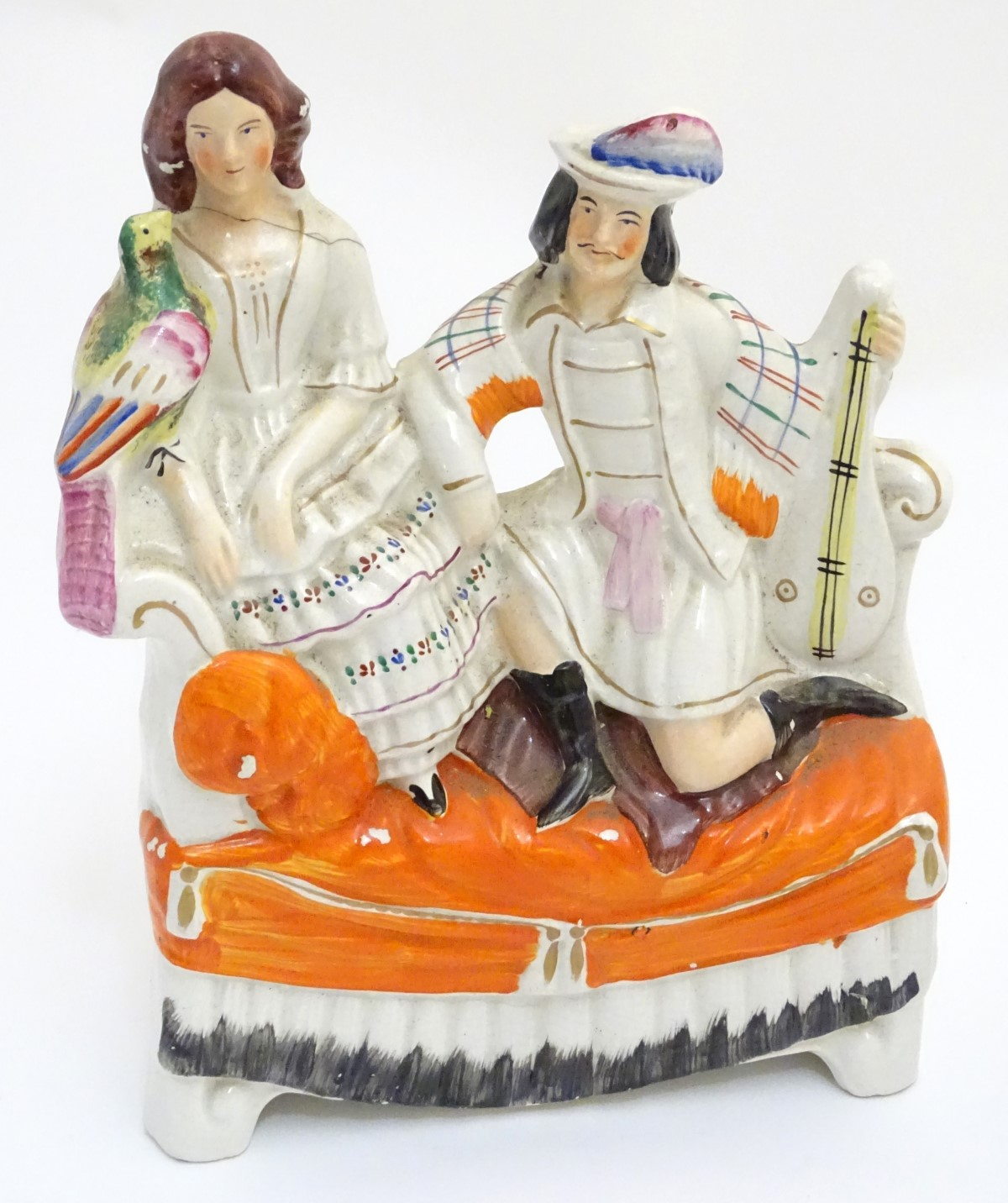 Lot 43 - A 19thC Staffordshire flatback figural group of a man with a musical instrument and a woman with a