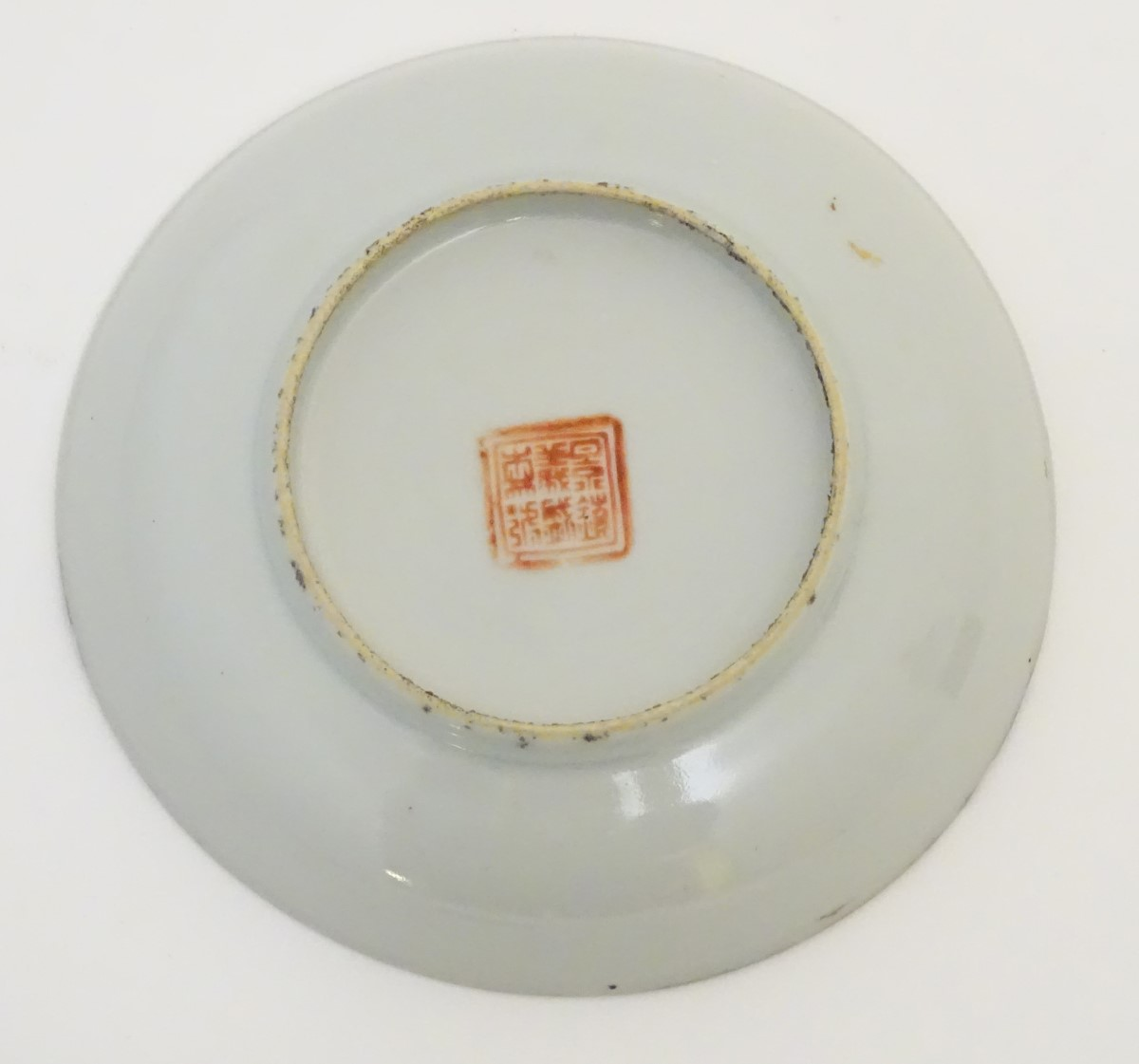 Lot 3 - A small Chinese famille rose dish, decorated with three horses in a landscape with gilt highlights.