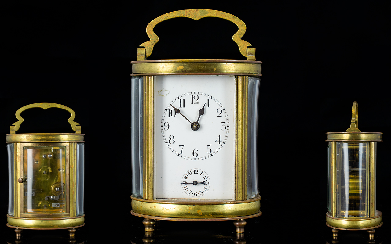 Lot 53 - French - Late 19th Century Brass Oval Shaped and Footed Carriage Clock,