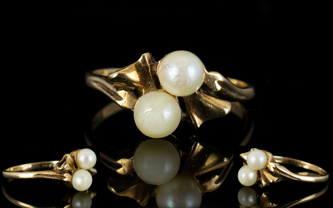 Lot 37 - Ladies Attractive Pearl Set 9ct Gold Dress Ring, The Two Pearls Set In a Bow Tie Design.