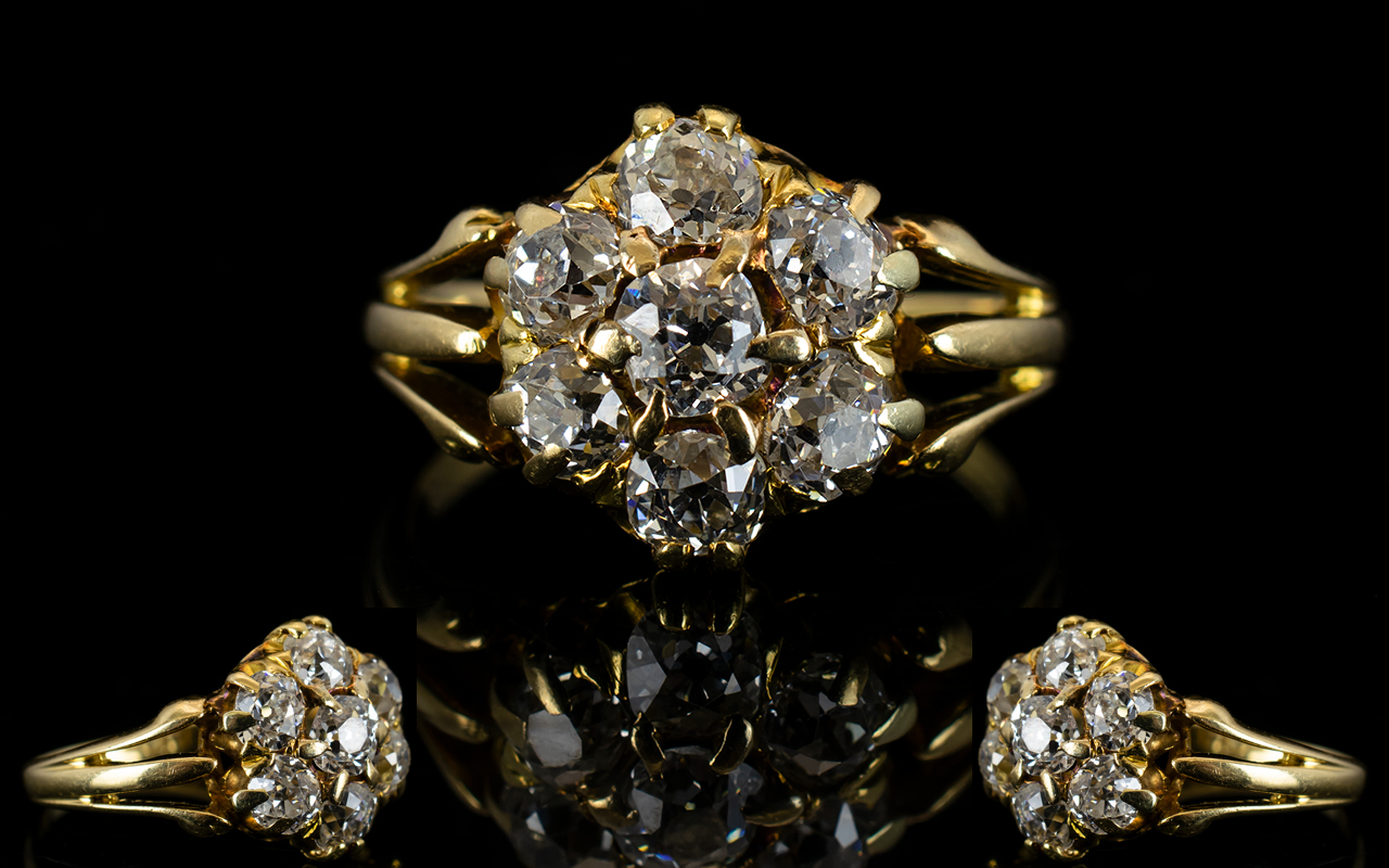 Lot 50A - Antique 18ct Gold And Diamond Cluster Ring Set with seven old round cut diamonds in a flowerhead