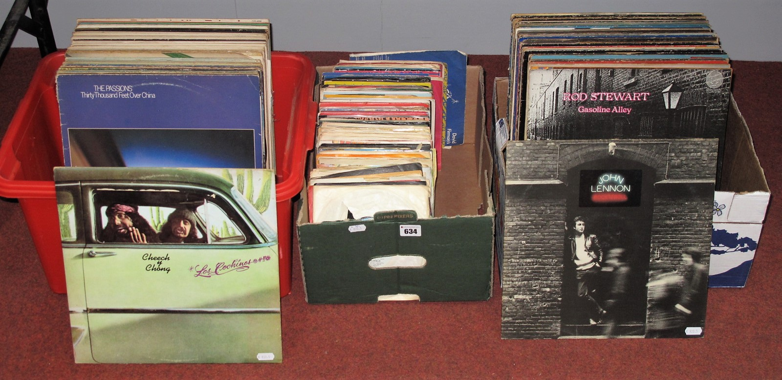 Lot 634 - A Quantity of LP's and 45rpms. To include John Lennon, Paul McCartney, Dire Straits, Boston, Rod