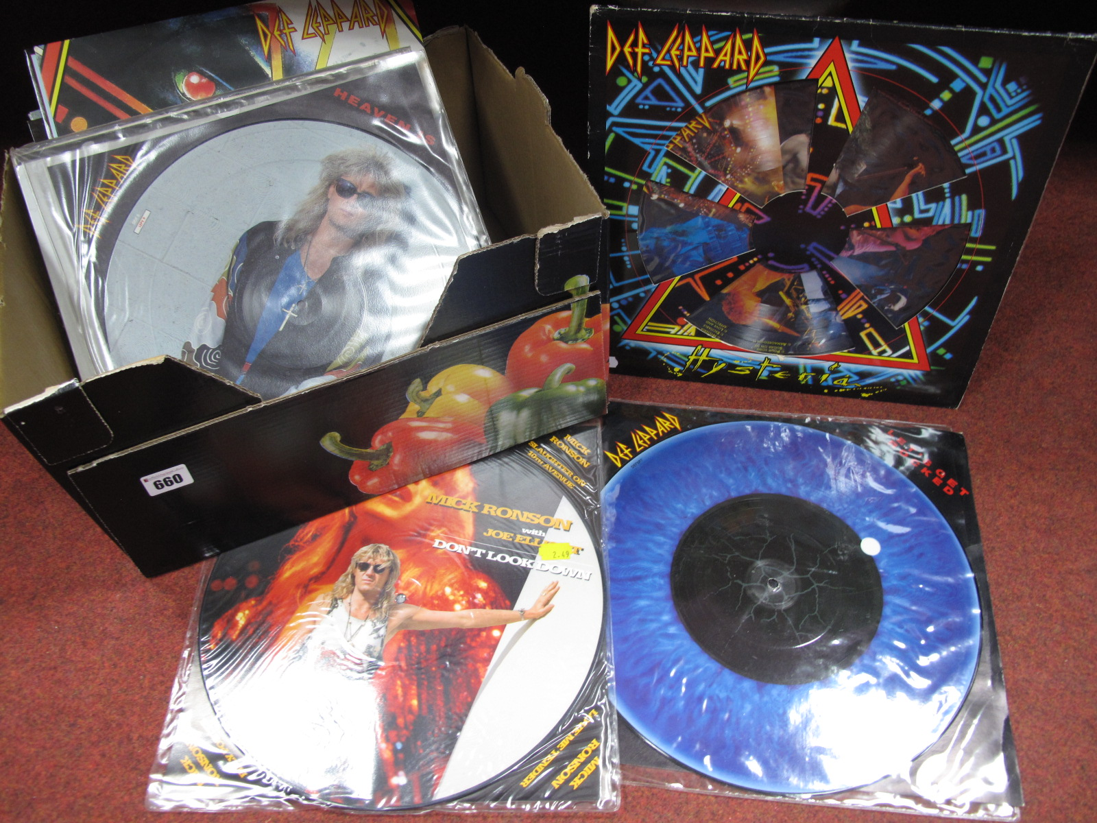 "Lot 660 - Def Leppard, a great batch of LP's, 12"" singles and shaped 7"" single picture discs, including '"