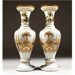 A GOOD PAIR OF 19TH CENTURY OPALINE VASES with gilt and coloured decoration. 14ins high.