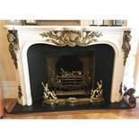 A GOOD LOUIS XVI WHITE MARBLE AND ORMOLU FIRE SURROUND, with serpentine shape mantle, the frieze