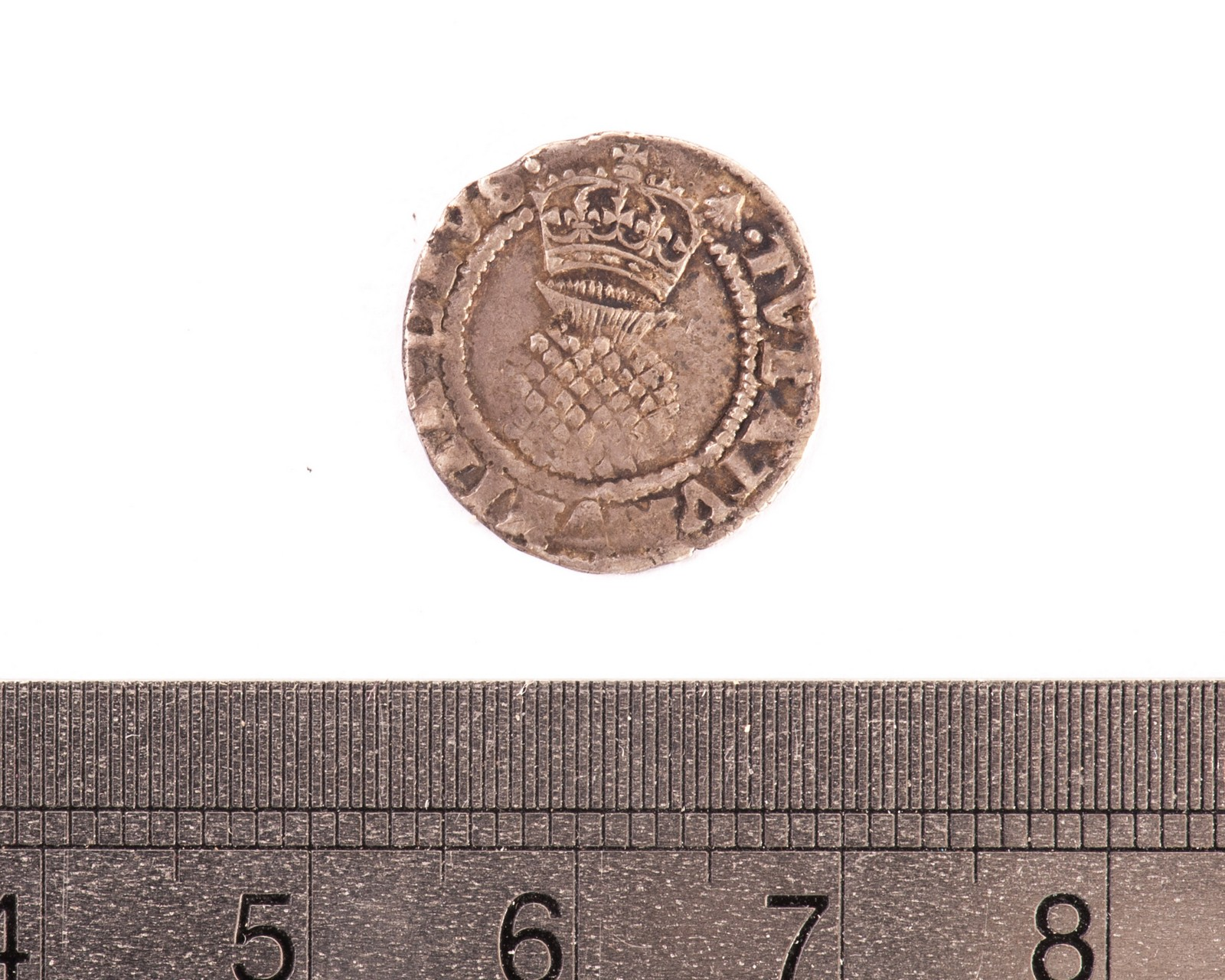 Lot 127 - A Tudor period penny, having tudor rose below coronet, the reverse with bag below crown, F