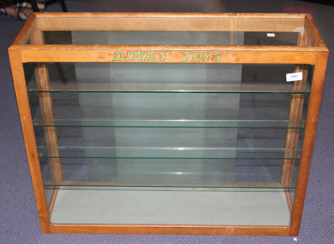 A Dinky Toys Oak Glazed Shop Display Cabinet Fitted With Four