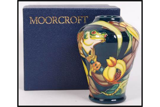 A Moorcroft ceramic tube lined vase decorated in the Amazon