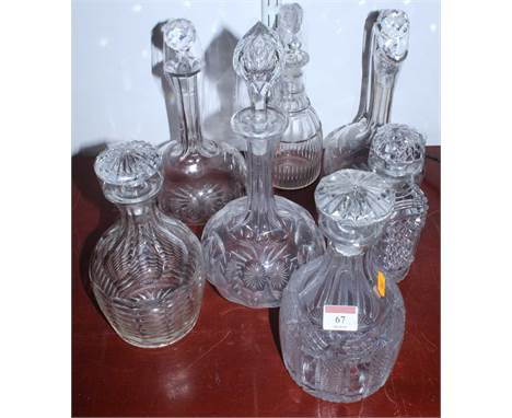 A cut glass decanter having a mushroom stopper together with various other decanters, and ewer (7)