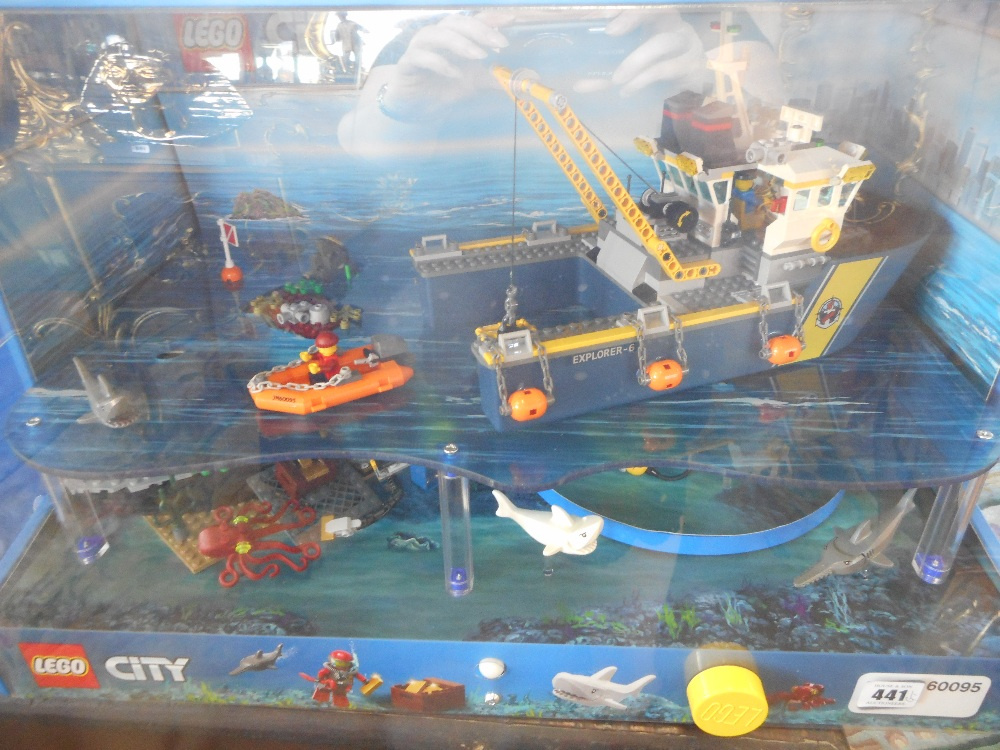 A lego city ex shop display in a lighted case for Case lego city