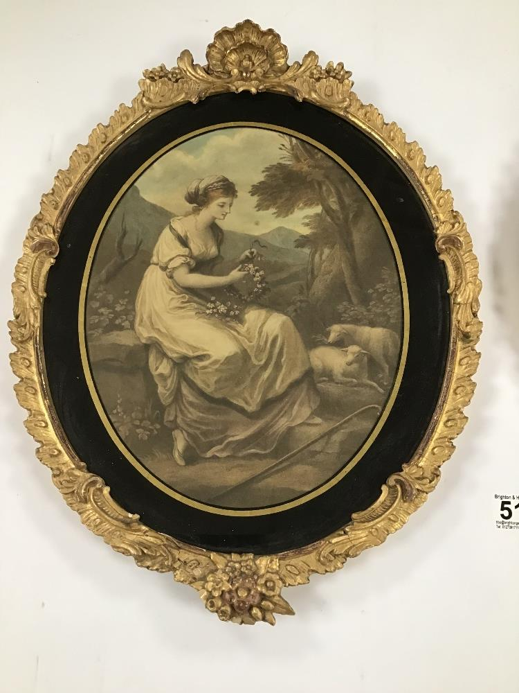 Lot 517 - A PAIR OF ANTIQUE ORNATE GILT FRAMED AND GLAZED OVAL PRINTS OF WOMEN, 44CM BY 34CM