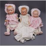 Three Armand Marseille 'My Dream Baby' bisque head dolls, each with moulded hair,