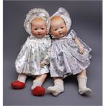 Two Armand Marseille 'My Dream Baby' bisque head dolls, each with moulded hair, sleeping eyes,