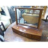 A LATE GEORGIAN STYLE MAHOGANY BOW FRONTED BOX TOILET MIRROR