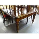 VICTORIAN LARGE DINING TABLE HAVING ROUNDED CORNERS ALL RAISED ON TURNED FLUTED SUPPORTS AND