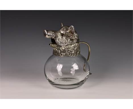 A novelty Continental silver plate glass carafe mounted with a wild boar's head, 1960s, the clear glass bulbous body mounted