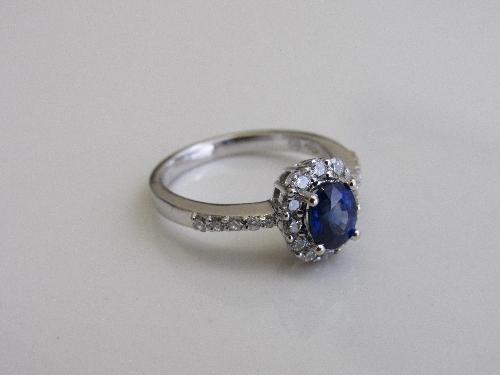 Lot 337 - 18ct white gold, sapphire & diamond ring, size M 1/2, weight 4.3gms. Estimate £200-250.