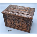 Lot 21 - An oak stationary box carved with oak leaves and acorns,