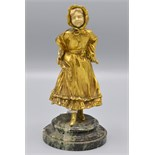 Lot 1 - An Austrian gilt bronze and ivory figure of a girl in the manner of Kate Greenaway,