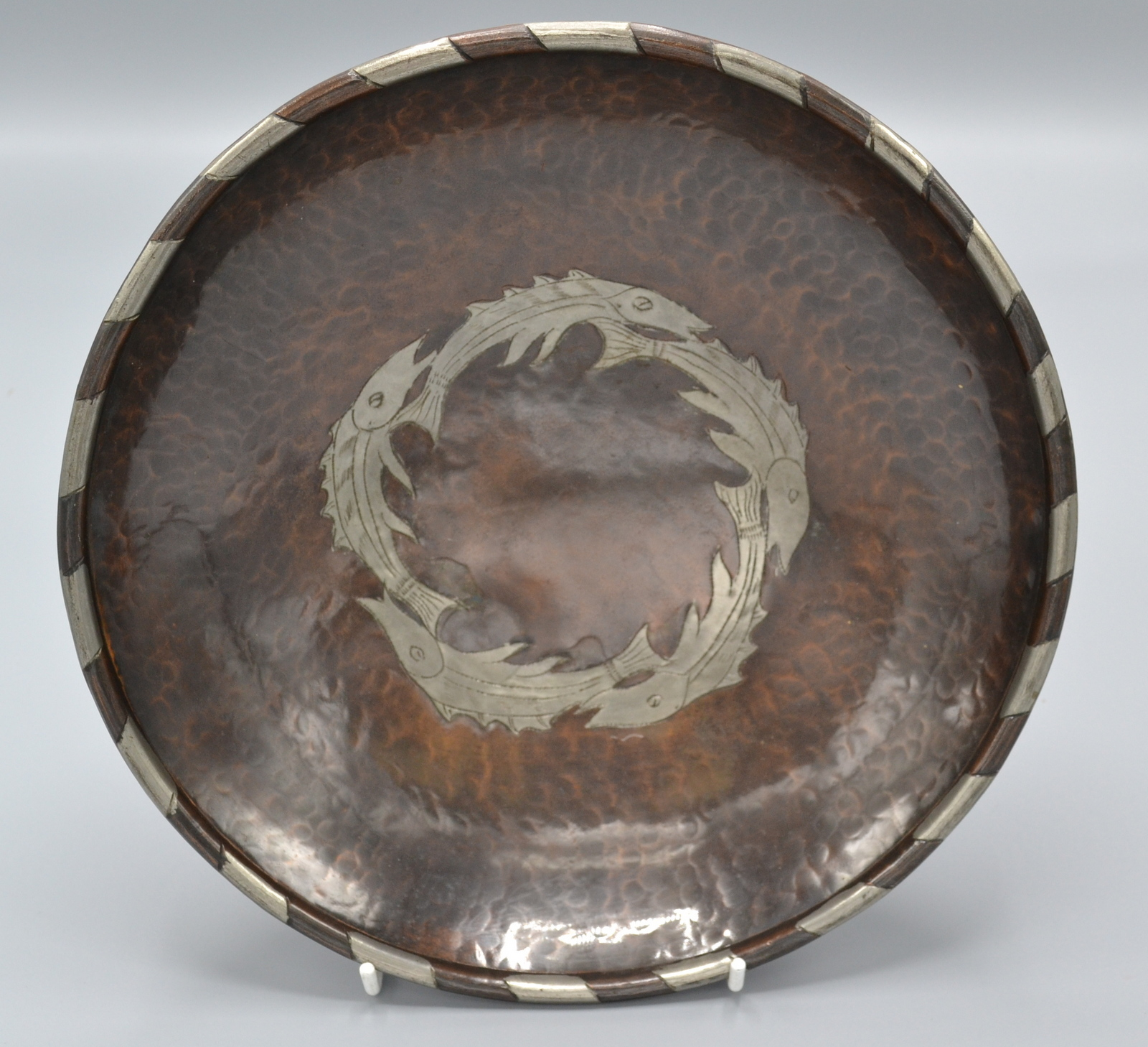 Lot 26 - Hugh Wallis, an Arts and Crafts circular, planished copper bowl,