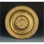 Lot 43 - A 16th century Neuremburg brass alms dish,