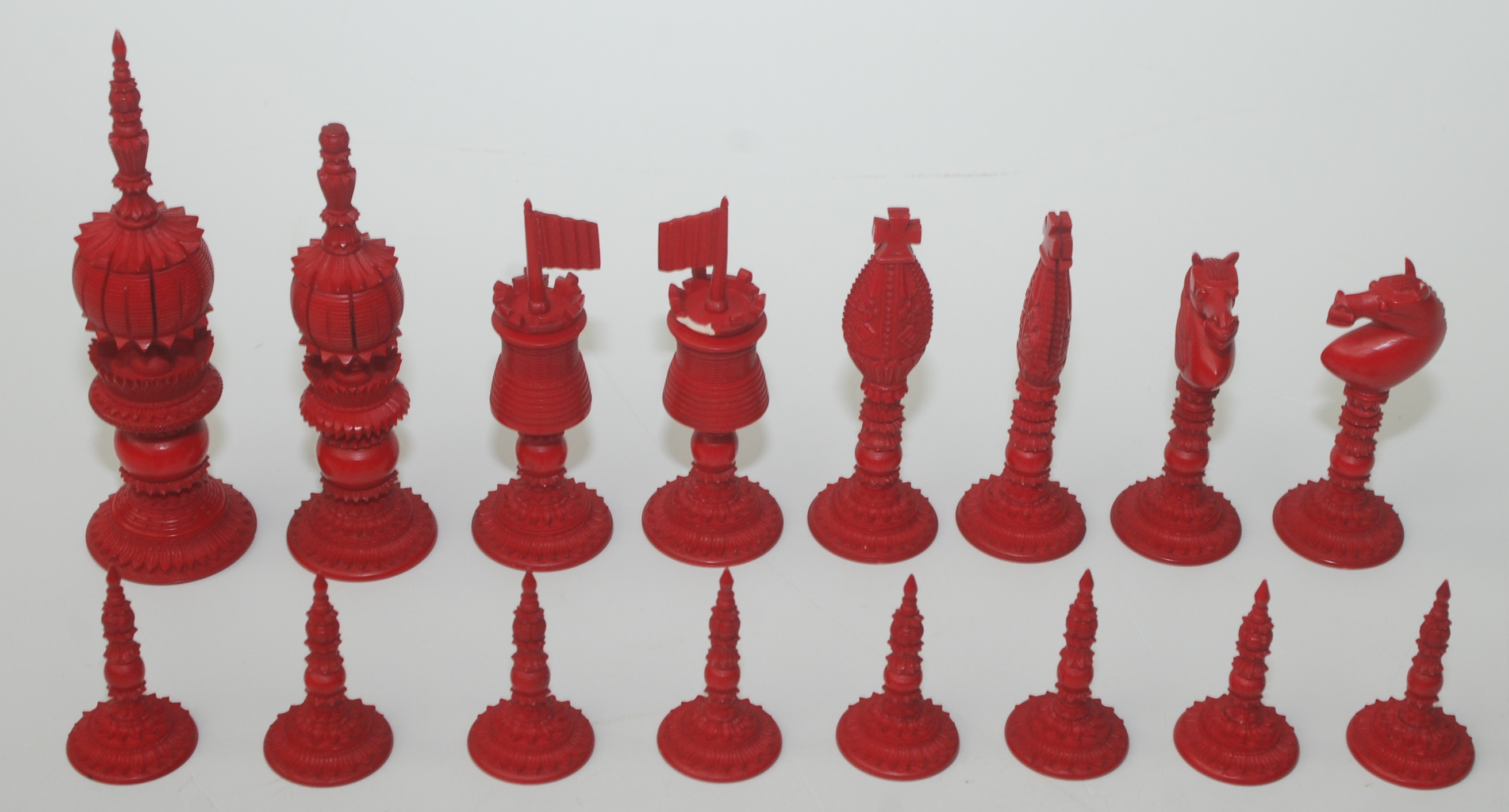 Lot 34A - A fine 19th century English ivory chess set of John Barleycorn type, natural and stained red,