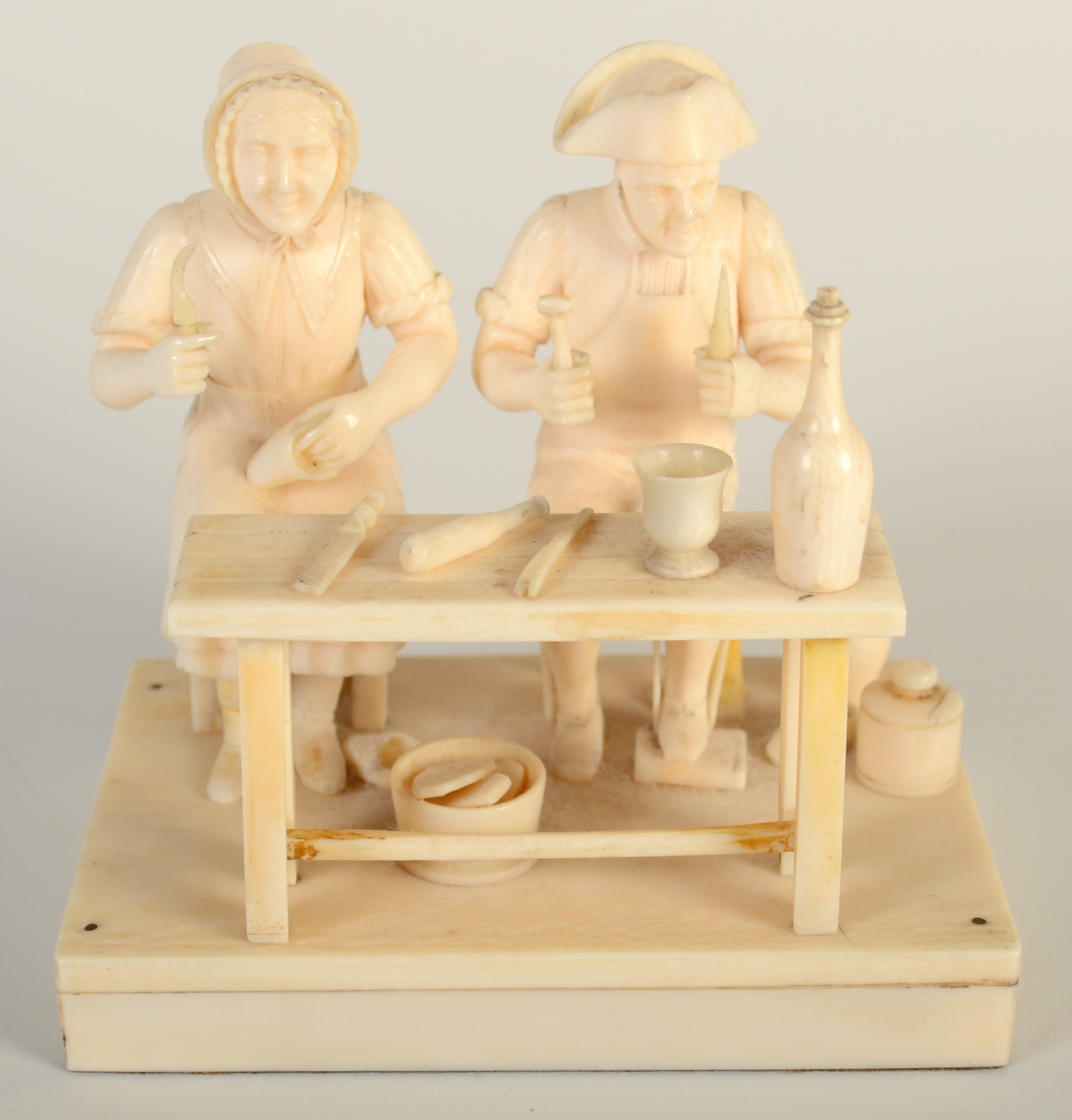 Lot 12 - A Dieppe ivory group of a cobbler and his wife,