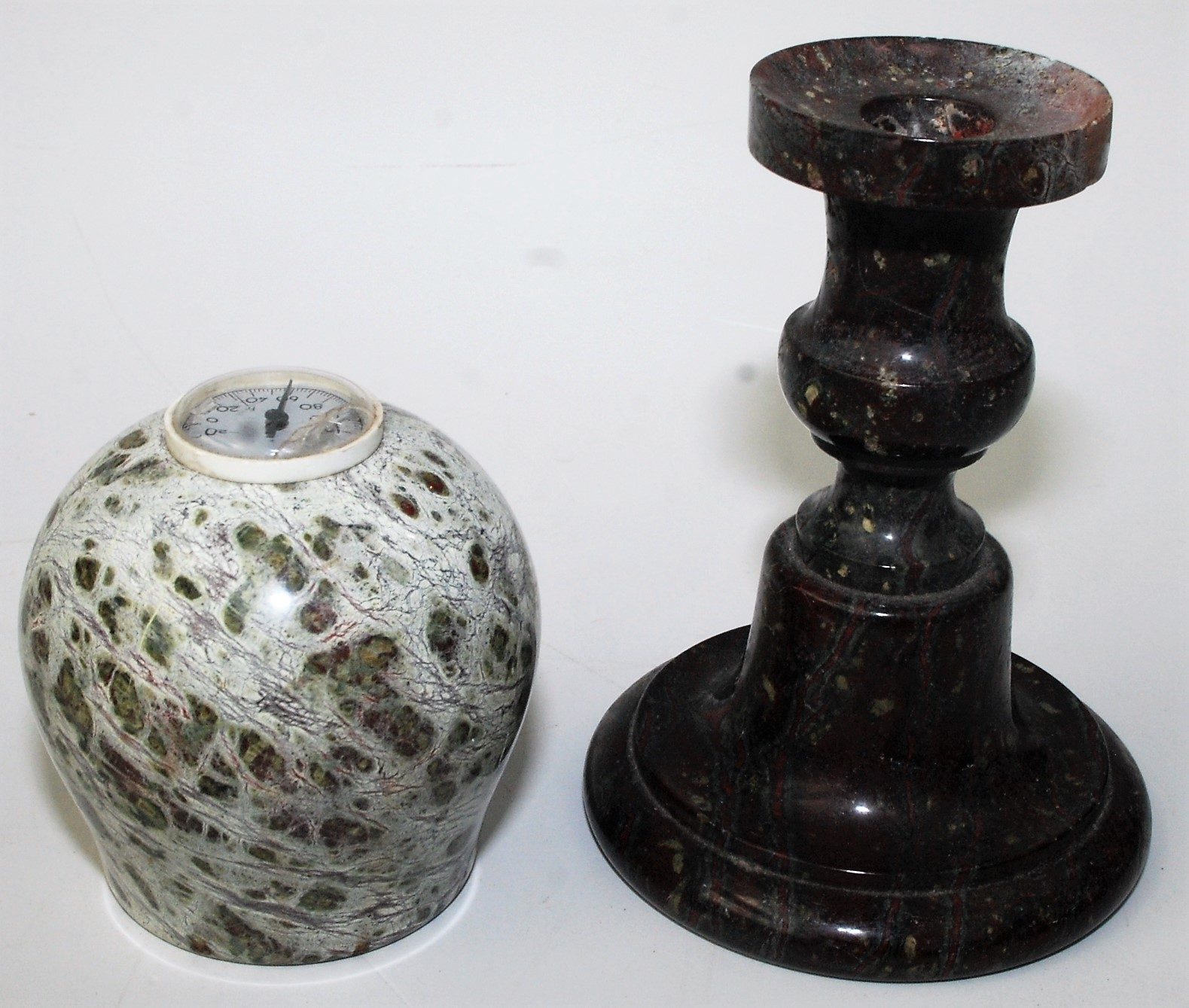 Lot 16 - A turned serpentine candlestick,