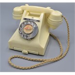 Lot 44 - A GPO 300 series 1940s/50s ivory bakelite dial telephone with call exchange button,