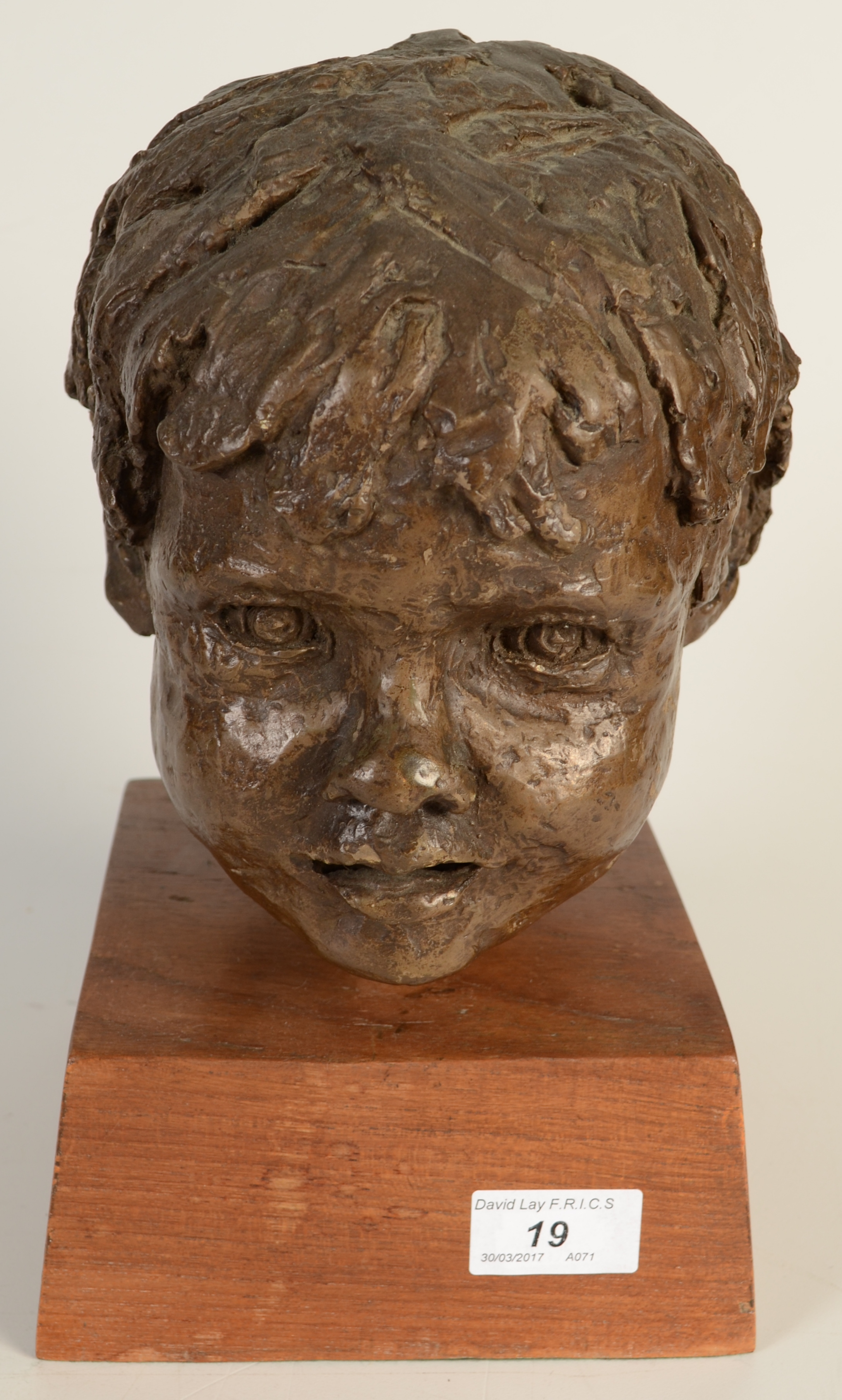 Lot 19 - A resin sculpture, the head of a child on an oak base, monogrammed PMV (?), full height 28cm.