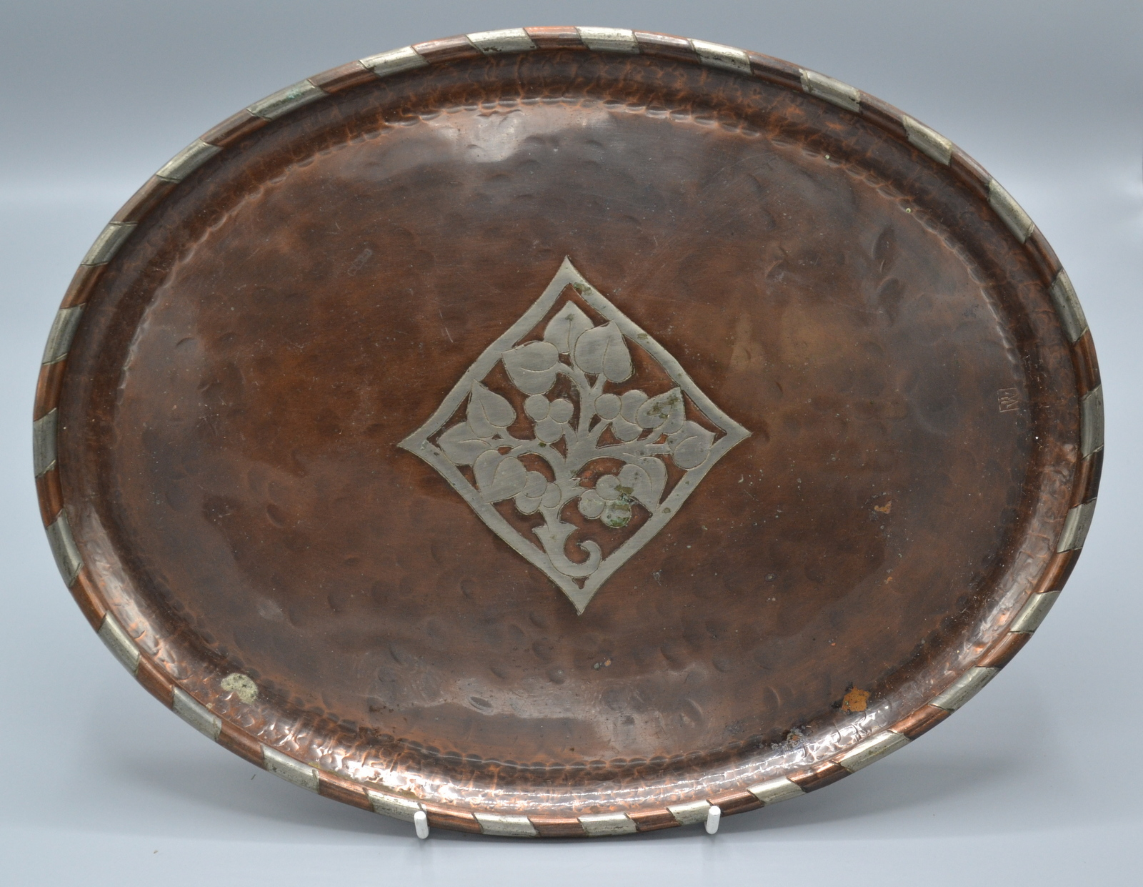 Lot 28 - Hugh Wallis, an Arts and Crafts oval, planished copper tray,