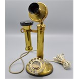 Lot 47 - A brass candlestick telephone.