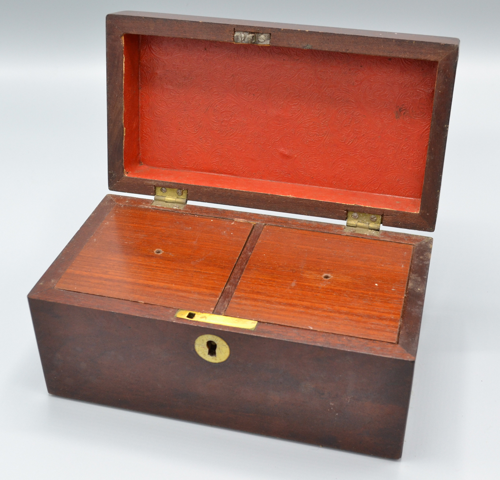 Lot 37 - A George III mahogany two section, rectangular tea caddy with mother of pearl escutcheons, width 20.