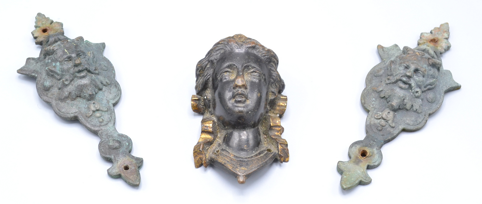 Lot 23 - A pair of gilt metal satyr cast furniture mounts and one other similar mount cast as the head of
