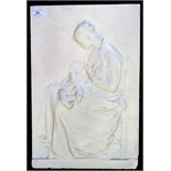 Lot 31 - A moulded plaster plaque showing a mother breastfeeding a child, 47 x 31cm.