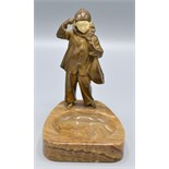 Lot 2 - An Austrian bronze and ivory model of a young Pierrot holding a mandolin,