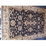Lot 2965 - A machine made rug of Ziegler design, the indigo field with a lobed medallion with scrolling vines,