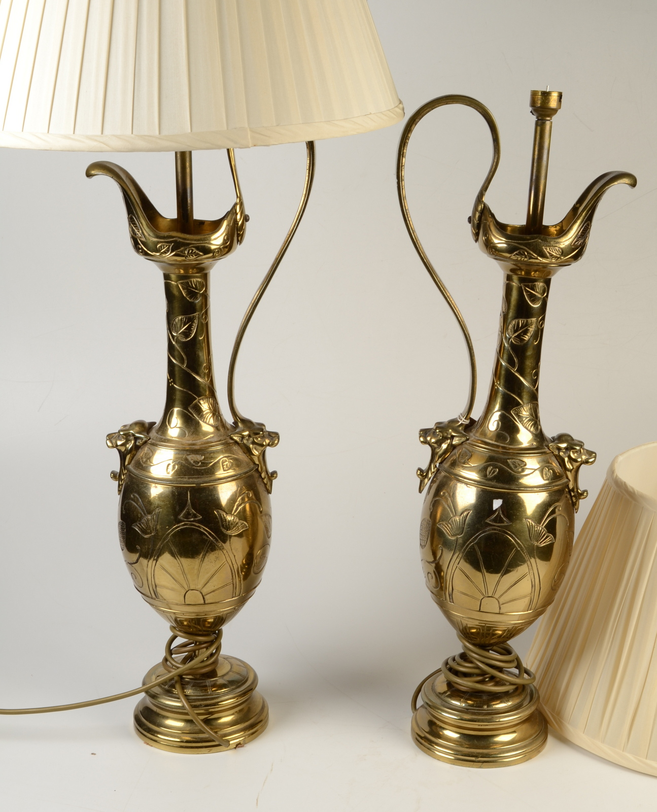 Lot 46 - A pair of impressive Aesthetic Movement brass table lamps of ewer form.