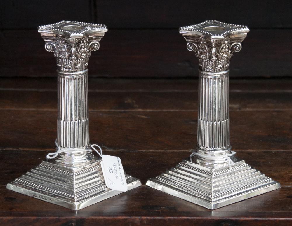 A Pair Of Victorian Silver Dwarf Candlesticks Corinthian
