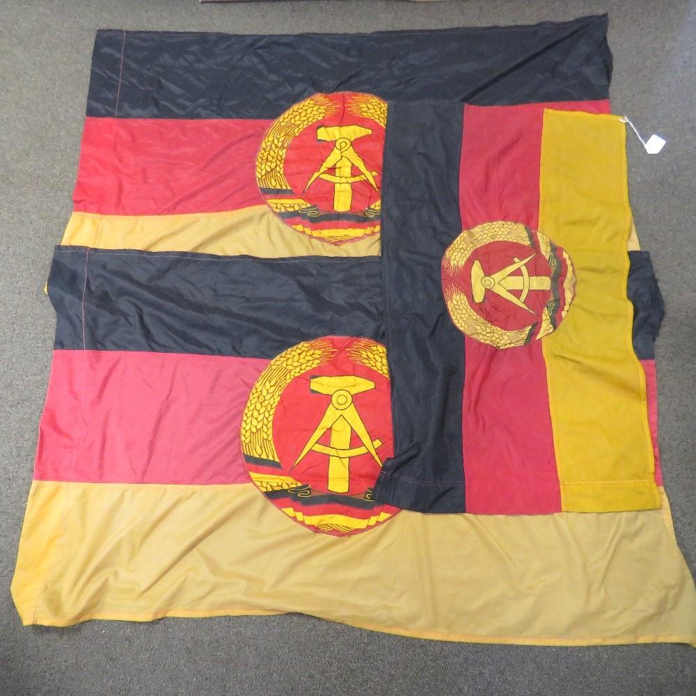 Three East German flags