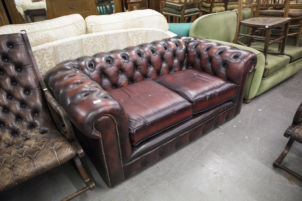Lot 9 - A MODERN BROWN LEATHER TWO SEATER CHESTERFIELD SOFA (WORN)